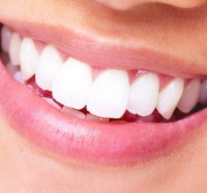 Коронка на зуб: особенности конструкции и ее использование