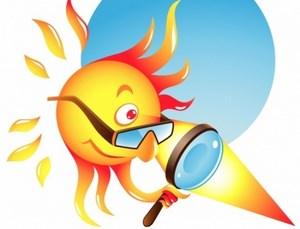 Солнце смотрит через очки и лупу